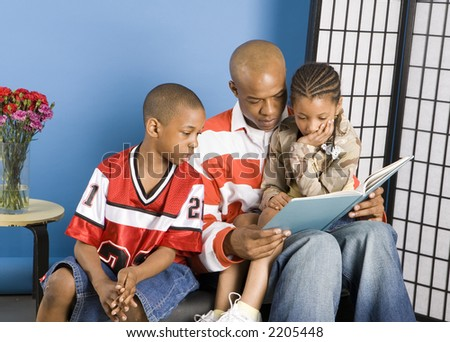 Children being read a story - stock photo