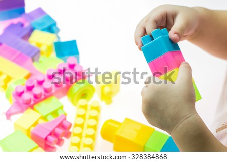 Children blocks toy on white background