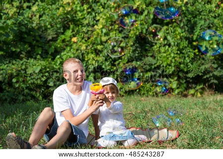 Children blow bubbles in the park