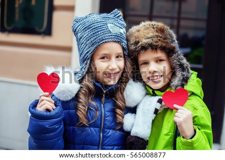 Children boy and girl with hearts. The concept of friendship, love, Valentine's Day.