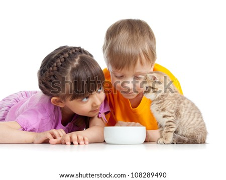 children boy and girl with young cat - stock photo