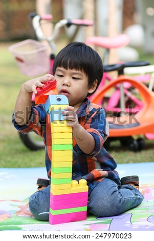children boy playing toy in playground nature.