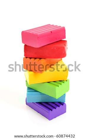 Children bright multicoloured plasticine in the column  isolated on white - stock photo