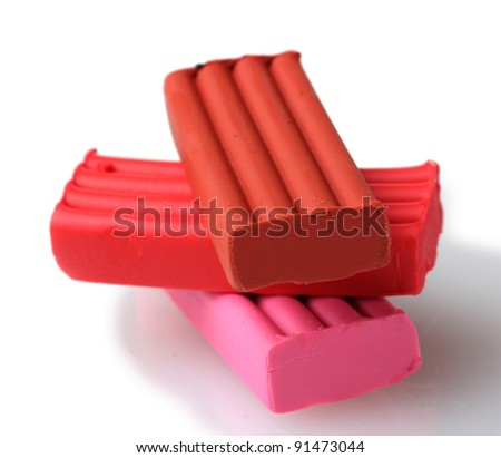 Children bright pink and red plasticine isolated on white