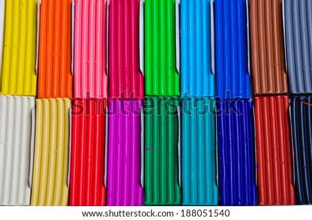 Children bright plasticine in paper box isolated on white  - stock photo
