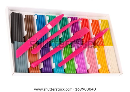 Children bright plasticine in paper box with stacks isolated on white