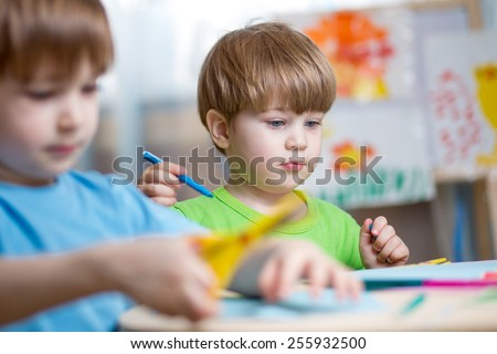 children brothers painting in nursery at home - stock photo