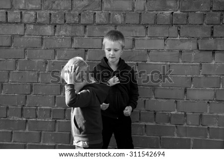 children bullying and fight between two angry aggressive brothers (kids, boys) - stock photo