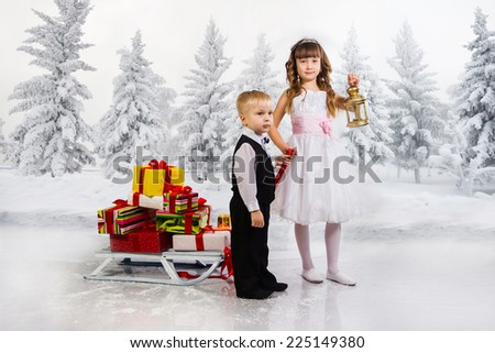Children carry a heap of gifts on a sledge. Collage. - stock photo