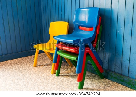 Children chairs in the playroom. - stock photo