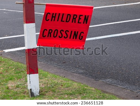 Children crossing closeup sign outdoors - stock photo