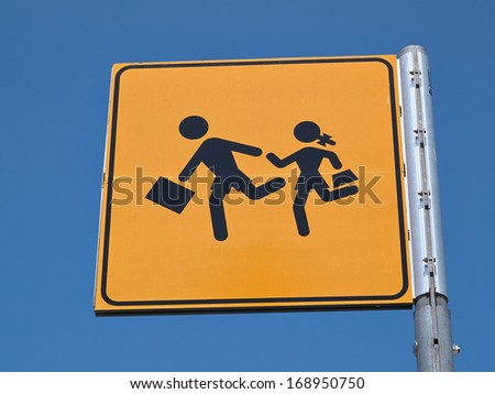 Children crossing street road sign back to school image  - stock photo