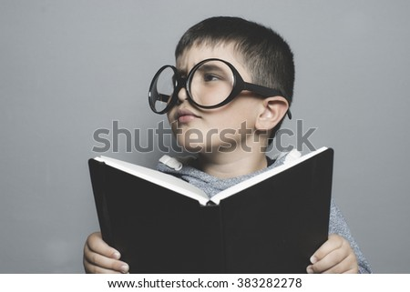 children, dark-haired young student reading a funny book, reading and learning