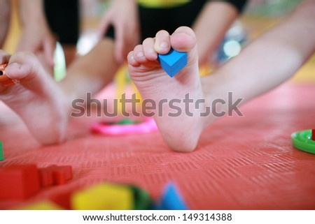 children do improving massage of feet and develop a motility of fingers