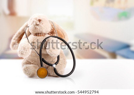 children doctor concept - rabbit with stethoscope. copy space