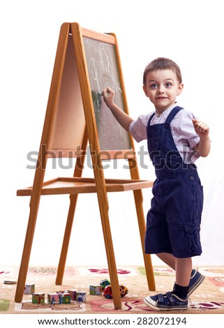 children draw children draw with chalk on a blackboard white background - stock photo