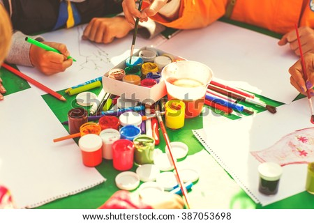 children draw with parents paint beautiful pictures, children's creativity - stock photo