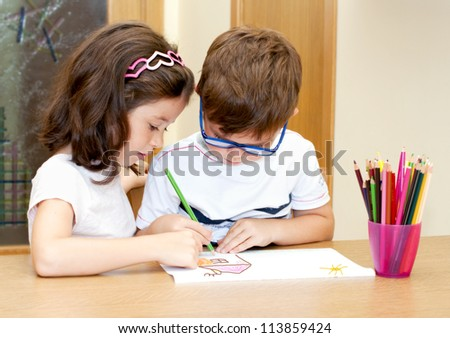 Children drawing together, brother and sister
