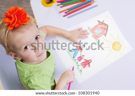Children drawings. Cute child draw with colorful crayons - stock photo