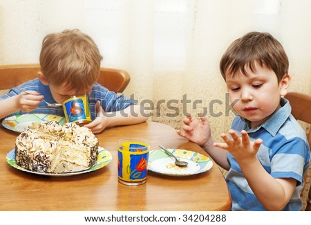 Children eat a pie