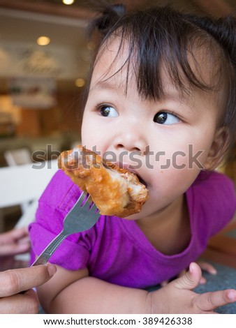 Children eat fried chicken