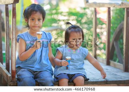 Children eat ice cream