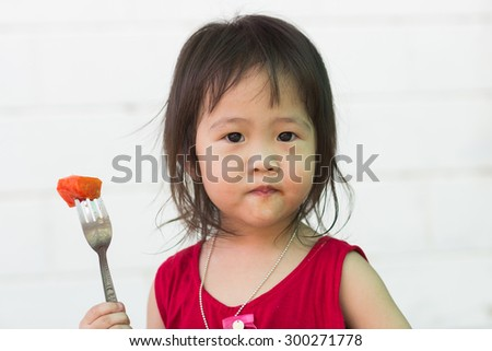 Children eat papaya - stock photo