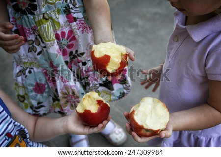 Children eating apples  - stock photo