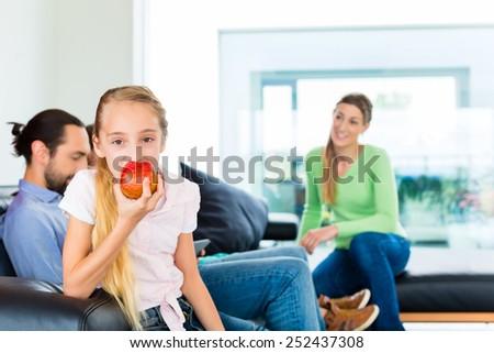 Children eating fresh appels for healthy living  - stock photo