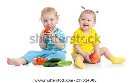 Children eating fruits and vegetables isolated - stock photo