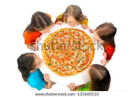 Children eating huge pizza - stock photo