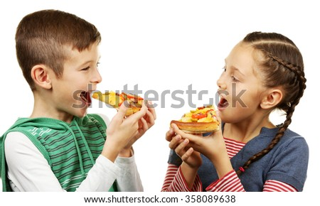 Children eating pizza isolated on white
