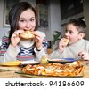 Children eats pancakes - stock photo