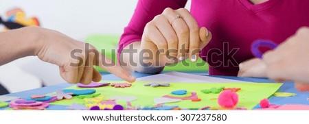 Children enjoy art lesson with creative teacher at kindergarten - stock photo