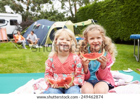 Children Enjoying Picnic Whilst On Family Camping Holiday  - stock photo