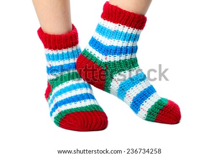 Children feet clothed in colorful socks isolated on white background
