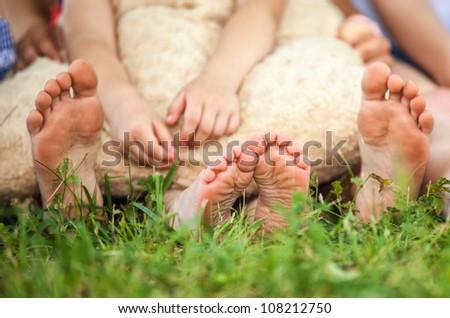 children feet on a grass - stock photo
