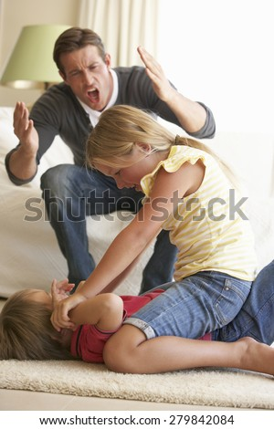Children Fighting In Front Of Father At Home - stock photo