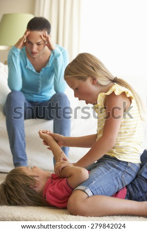 Children Fighting In Front Of Mother At Home - stock photo