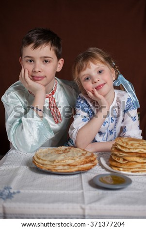 children for a holiday with pancakes