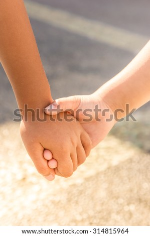 Children Friendship Family Relationship Hand in Hand Concept - stock photo