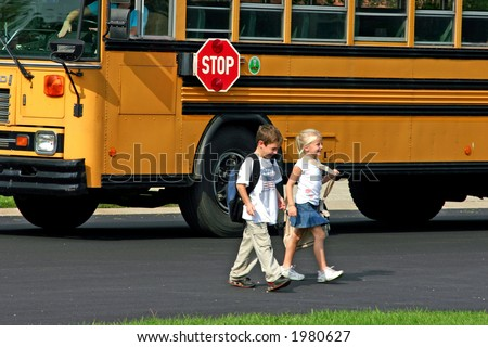 Children Getting off Bus - stock photo