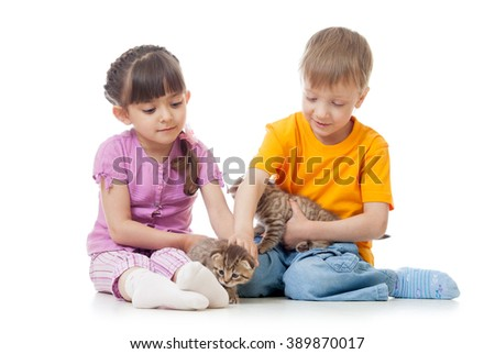 Children girl and boy stroking kittens