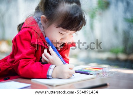 Children girl learning to write