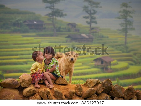 Children girl smile and dog of rice terraces background ,Tu Lu Yen Bai, Vietnam.