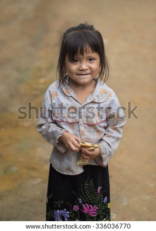 Children girl smile in traditional dress ,Tu Le Lao Cai,Vietnam.