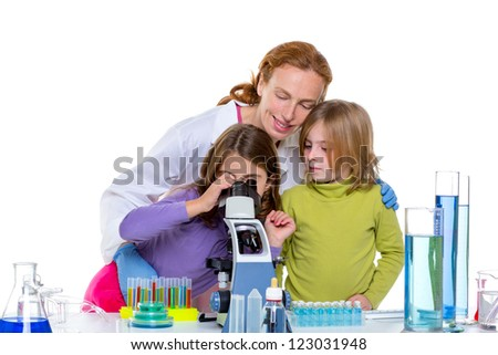 children girls and teacher woman at laboratory on school chemical class - stock photo