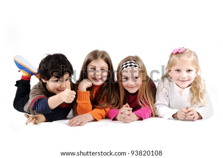 Children group family laying on floor ground isolated - stock photo