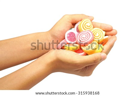 children hand hold jelly sweet candy isolated on white background - stock photo