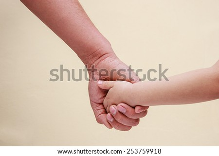 children hand in father's hand